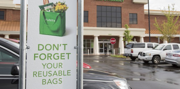 Store family night, Gastonia, NC, 1521, Charlotte,aquired Lowes Food store, July 6, 2016, reusable bag sign, cart return