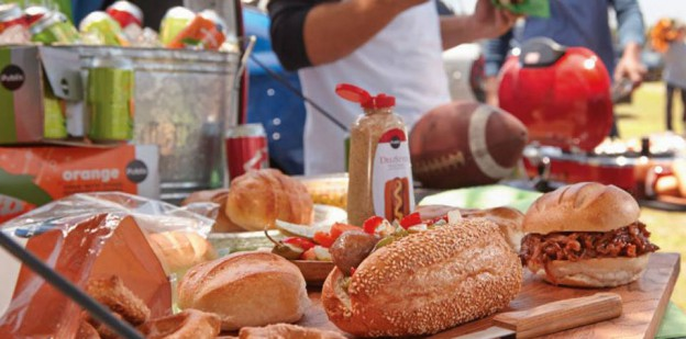 tailgate party table of sandwiches