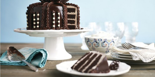 table setting with sliced chocolate cake