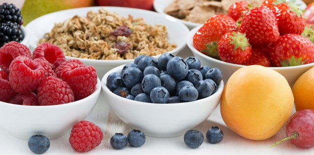fresh berries, fruit and muesli for breakfast, close-up, horizontal