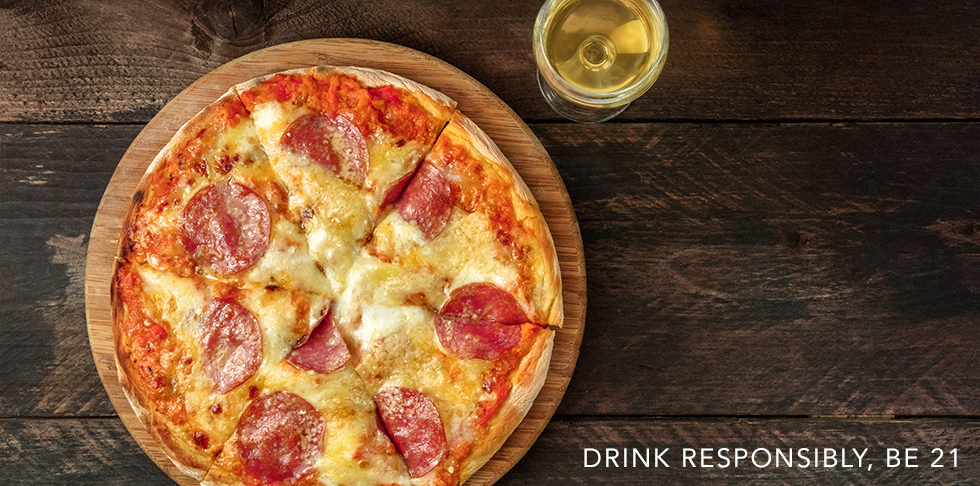 Pepperoni pizza with white wine, and place for text