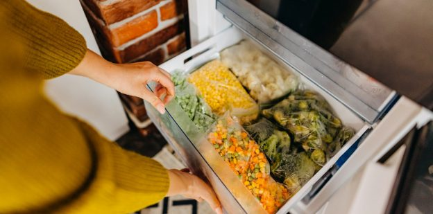 Freezer with packed vegetables.