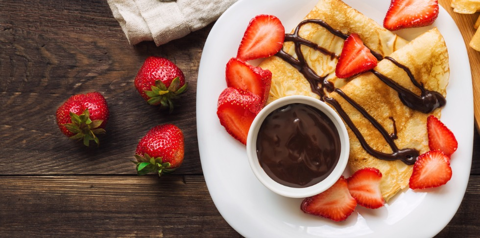 Crepe and Strawberries with Chocolate Sauce
