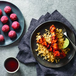 Barbecue chicken kabobs over cheesy rice w strawberry bites