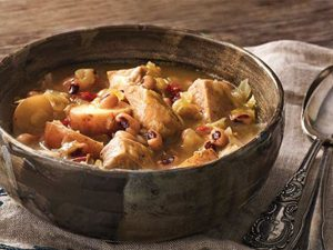 Publix Aprons pork and cabbage stew with black eyed peas recipe served in a bowl with spoon