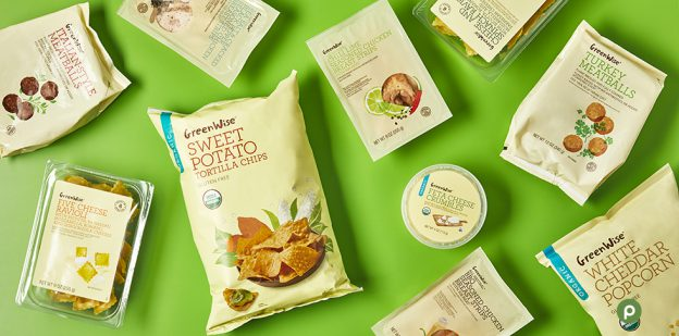 "alt= ""GreenWise products including tortilla chips, popcorn, chicken strips, feta cheese, pasta and meatballs on green background."""