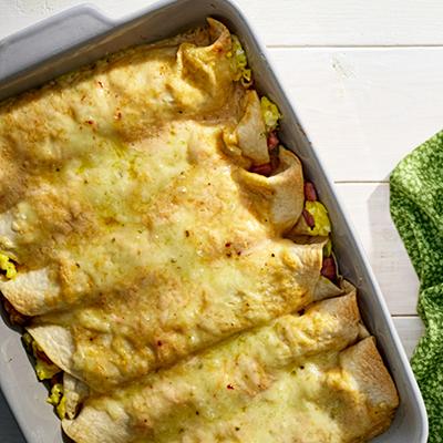 Breakfast enchiladas in casserole dish