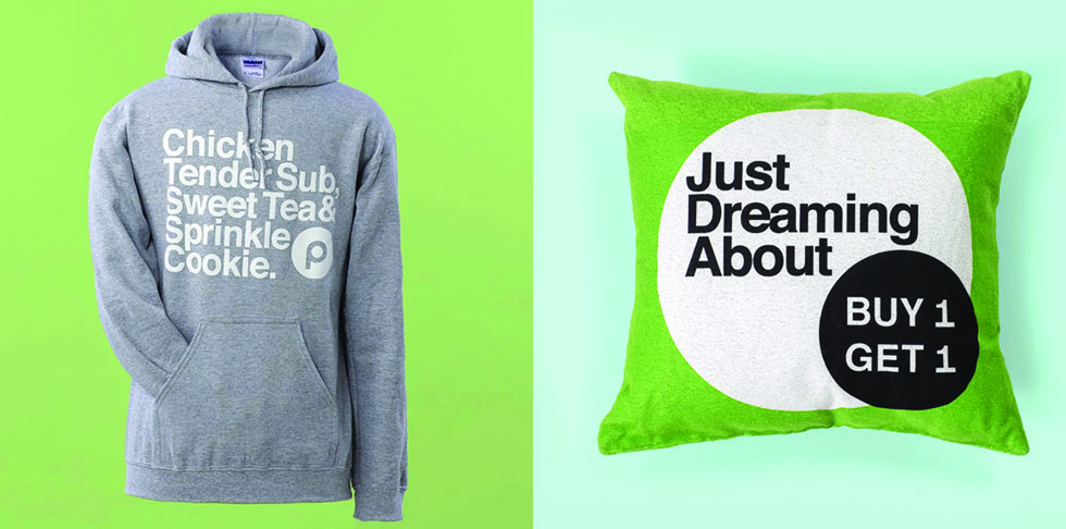 Grey hoodie with writing on it and Green pillow with writing on it
