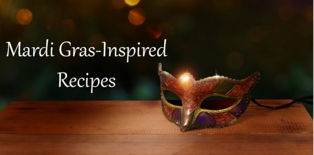 """Masquerade mask on wood surface with blurred writing and """"Mardi Gras-Inspired Recipes"""" written on photo."""