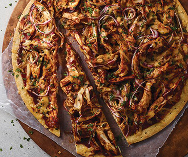 Flatbread pizza topped with barbecue chicken and gouda cheese
