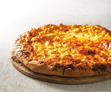 Pizza with buffalo chicken dip and cheese on top