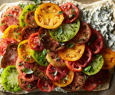 Flatbread with multicolored heirloom tomatoes and ricotta cheese