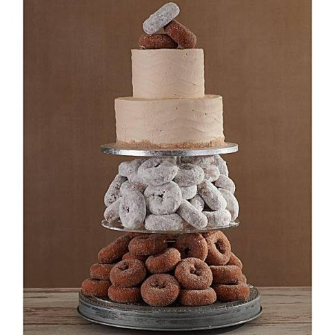 """Alt= """"Two tiers of powdered donuts with an iced two tiered cake on top"""""""