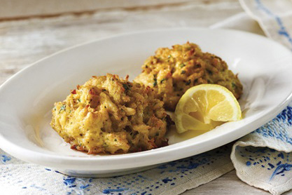 "Alt=""cooked crab cakes with lemon wedge on white plate"""