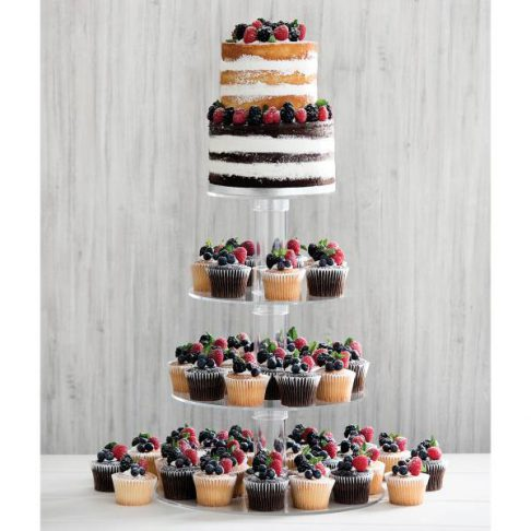 """Alt= """"Three tiers of vanilla and chocolate cupcake tower topped with blueberries and strawberries. Two tiers of vanilla and chocolate cake sit on top of the tower with buttercream icing and more fresh blueberries and strawberries"""""""