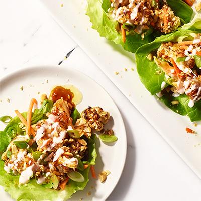 Cauliflower on lettuce on white plate