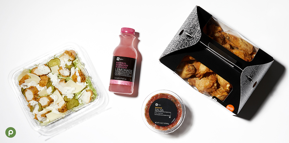 "Alt= ""Publix hot and spicy non-breaded wings, raspberry lemonade, salad and medium salsa in green shopping basket."""