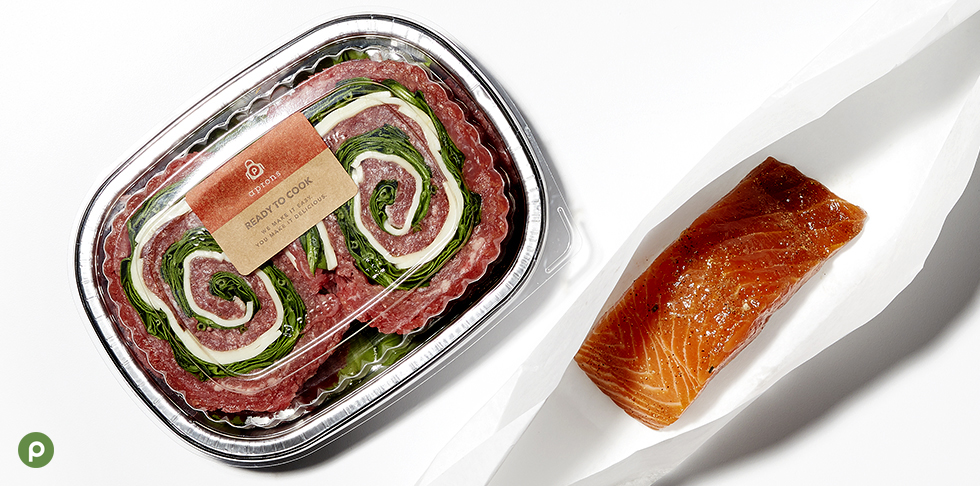 "Alt= ""Publix bourbon salmon and flank steak provolone spinach wheels in green shopping basket."""