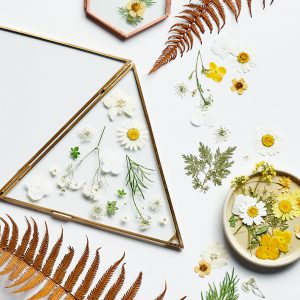 Pressed flowers in triangular gold frame