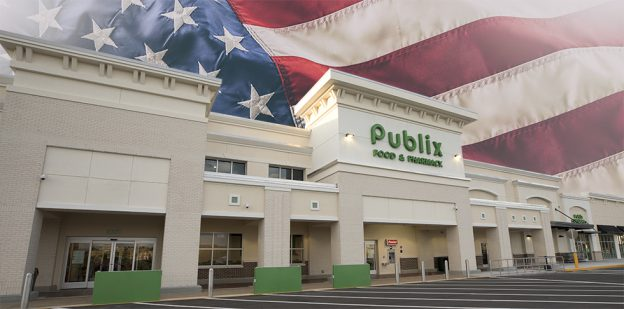 Exterior of Publix store with American flag in the background