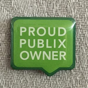 """Proud Publix Owner"" pin on grey background"
