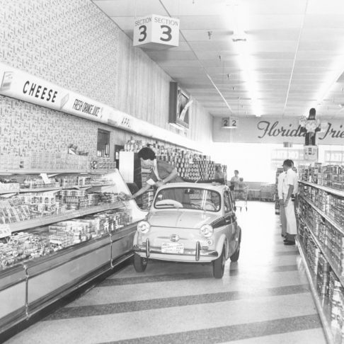 """alt= """"fiat driving through aisles in store"""""""