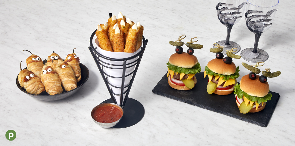 Jalapeno poppers, mozzarella sticks and sliders on a white background.
