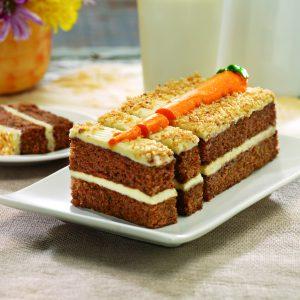sliced publix carrot bar cake on white plate