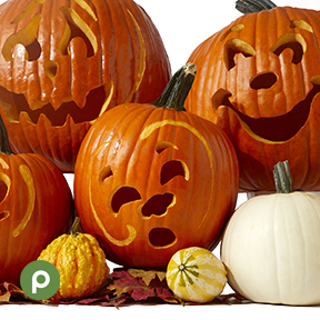 Three stacked pumpkins with carved faces