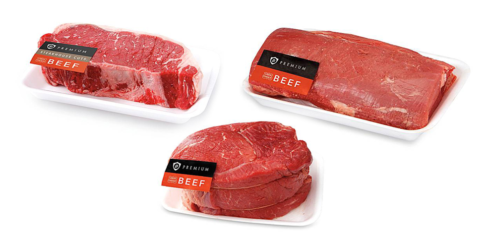Three packages of various cuts of beef on a white background.
