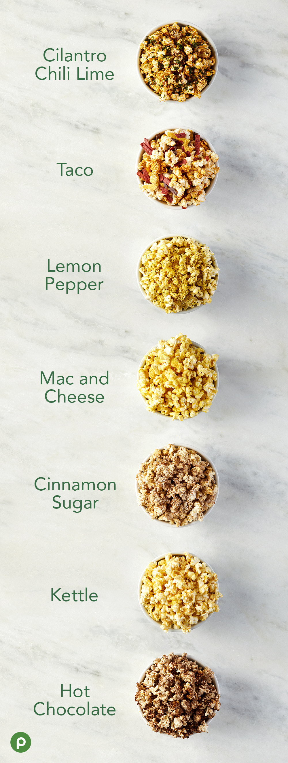 7 popcorn flavors in bowls on marble surface
