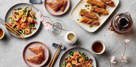 Asian-inspired cuisine on table