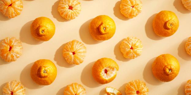 Sumo citrus on cream-colored surface.