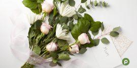 Publix DIY floral arrangement on white surface.