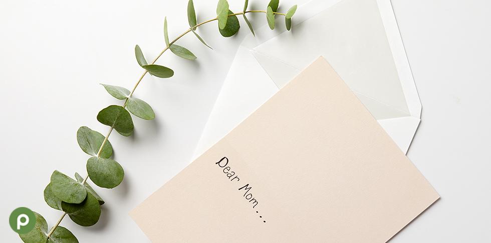 Dear mom card on white surface.