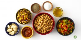 Ingredients for Publix Aprons recipe for chickpea sautee in separate bowls on top of a white surface