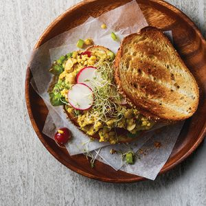 Publix Aprons recipe for Curried Chickpea Salad plated on wooden serving plate