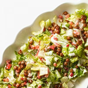 Publix Aprons recipe for Roasted Chickpea-Romaine Salad plated on white oval serving platter