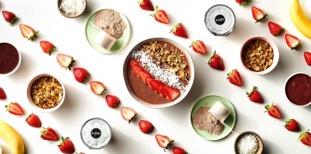 Ingredients for Publix Aprons recipe for Mocha Fruit Smoothie Bowl arranged in diagonal rows