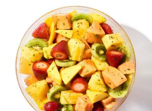 Tropical Holiday Fruit Salad Aprons Recipe in glass bowl.