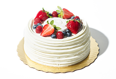 Close up picture of Publix bakery chantilly cake on top of a white surface