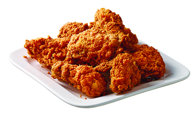 Publix fried chicken on top of a white plate in front of a white background