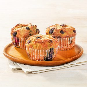 Publix Aprons blueberry and coconut flour muffins recipe plated on orange plate.