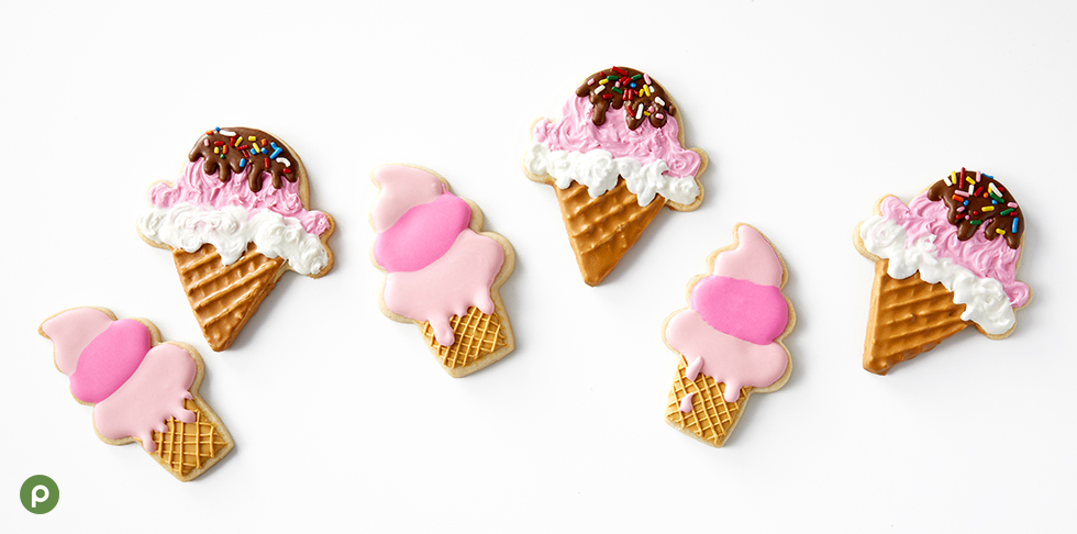 Ice cream-themed royal icing cookies on white surface