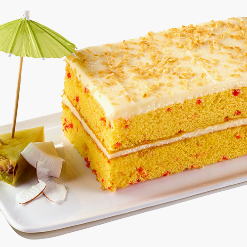 Close up of PublixBakery pina colada bar cake on a white plate with a slice of pineapple and chipped coconut