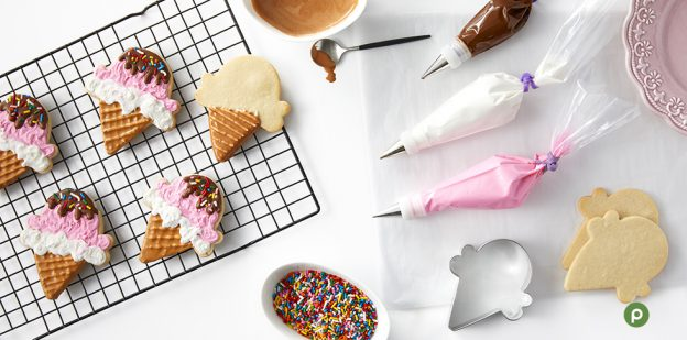 Ice cream-shaped royal icing cookies being decorated.