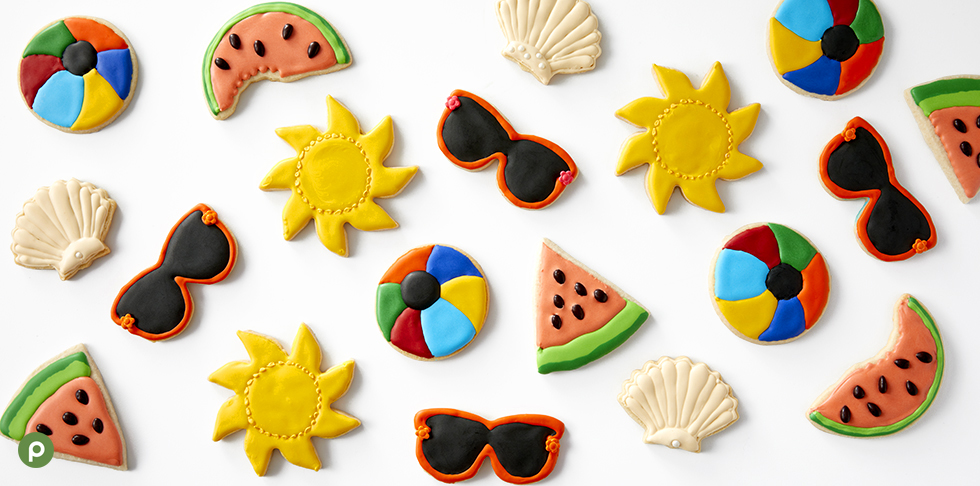 Summer-themed royal icing cookies on white background..