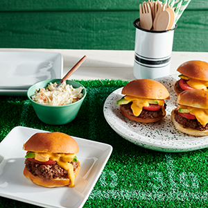Publix Aprons Taco Sliders recipe plated on tailgate-themed surface.
