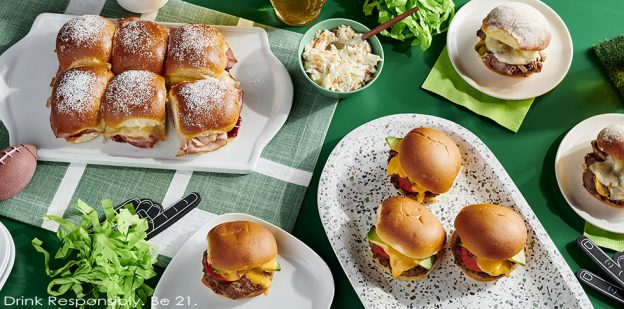 Tailgating slider burgers plated on tailgate-themed setting.