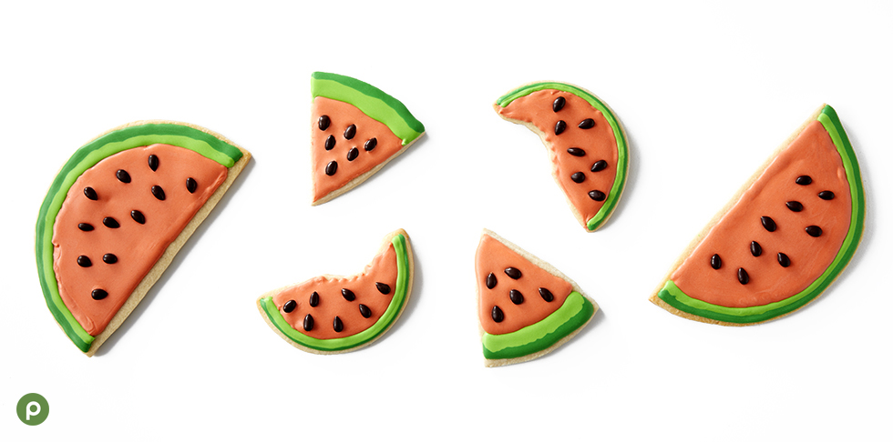 Watermelon royal icing decorated cookies on white surface.